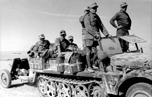 Afrika Korps - Anti-tank unit pulling a 37 mm gun comes to a halt.