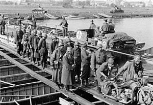 Battle of Sedan (1940) - German troops with French prisoners crossing the Meuse on 15 May 1940 near Sedan