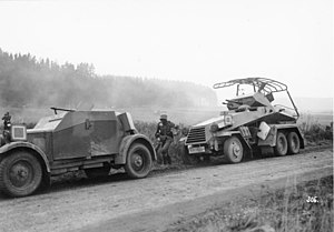 Kfz 13 - Left: a Kfz 13; right: an armoured Sd.Kfz. 232 with large loop antenna (6-wheeled radio and command vehicle)