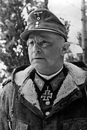 a black and white image of a male in uniform