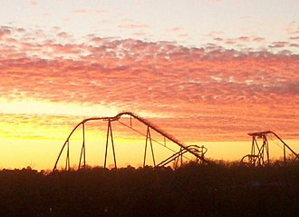 Grove, Virginia - On the western edge of Grove, a winter sunset silhouettes several of the roller coasters at the Busch Gardens Williamsburg theme park