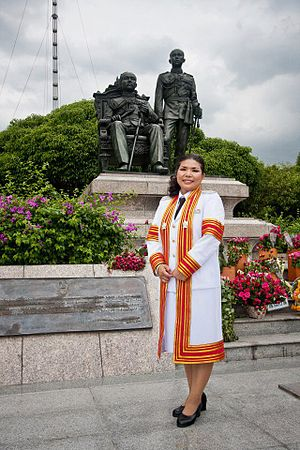 Graduate school - A doctoral graduate (PhD) of Chulalongkorn University in Thailand, dressed in an academic gown for her graduation ceremony.