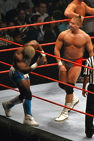 Bitch (slang) - Lance Cade bitch slaps Shelton Benjamin during the WWE Raw - Survivor Series Tour.