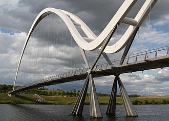 Tied-arch bridge - The Infinity Bridge in Stockton-on-Tees lines up two asymmetrically sized tied arches.
