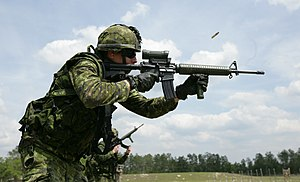 Colt Canada C7 - A Canadian soldier fires the current issue C7A2 assault rifle at the range with a C79A2 sight. This particular example is missing the standard TRIAD mount.