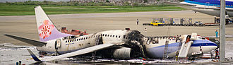 Emergency airworthiness directive - The burnt-out wreckage of China Airlines Flight 120; following this incident, the FAA issued an emergency airworthiness directive.