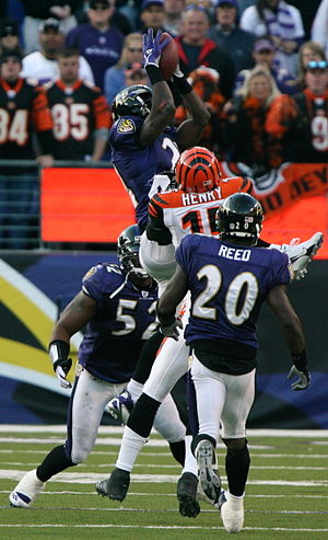 Ed Reed - Reed (20), Ray Lewis, and Chris McAlister playing for the Ravens against Chris Henry of the Cincinnati Bengals in 2006.