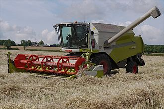 Farmer - A combine harvester on an English farm