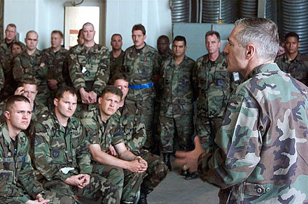 Clark briefs U.S. airmen from the 510th and 555th Fighter Squadrons at Aviano Air Base, Italy in May 1999. Clark briefs NATO May 9.JPEG