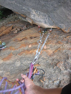 Traditional climbing - A climbing anchor; in this example, all three pieces are placed in the same crack. Generally anchor pieces should be placed in different features, where possible, to protect against rock failure.