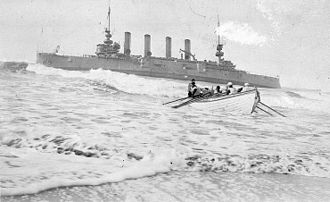 Humboldt Bay Life-Saving Station -  Crew from the Humboldt Bay Life-Saving station rescuing sailors from the wrecked U.S.S. Milwaukee, January 13, 1917. Note how many sailors line the rails.