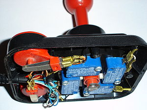 Atari CX40 joystick - Happ's Competition Pro used microswitches in place of Atari's membrane switches. The stick (red) presses on the switch actuators (white part on blue components).
