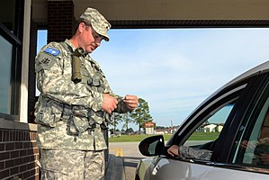 South Carolina State Guard - Cpl. Paul Herring, a security augmentee assigned to the 3rd Battalion, 1st Brigade of the South Carolina State Guard, guarding the front gate at McCrady Training Center, S.C.
