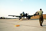 DF-ST-83-07415 An A-10 Thunderbolt II aircraft is marshalled off the runway apron upon its arrival during Reforger 82.jpeg