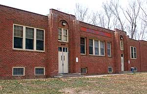 Waverly, Colorado - Waverly School front exterior.  The school was built in 1918 and served as K-12 school until 1960, when it was merged with the Poudre School District. It was closed in 1992 and was used as a youth center by the school district until 2004
