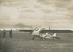 De Havilland DH.80A Puss Moth VH-UPN in field, 1930 - 1939.jpg