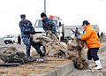 Defense.gov News Photo 110315-N-MU720-094 - Sailors assigned to Naval Air Facility Misawa help a Misawa City employee transport salvageable fishing equipment at the Misawa Fishing Port on.jpg