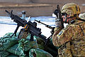 Defense.gov News Photo 120221-A-CZ512-498 - U.S. Army Sgt. Craig McComsey keeps a close watch from the rooftop of the district center building in Shah Joy Afghanistan on Feb. 21 2012.jpg