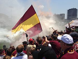 Detroit City FC - Detroit City FC supporters with the city's skyline behind them in during a match at Cass Tech in 2013.