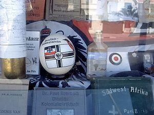 """German South West Africa - """"Deutsch-Südwest"""" devotionalia in a shop window in Swakopmund"""