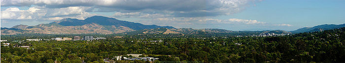 Central county scene — Mount Diablo and portions of Concord, Pleasant Hill, and Walnut Creek, with former grasslands now an urban forest in low density suburbs with extensive buisiness center and residential buildings near BART locations