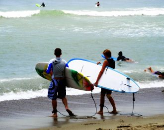 Dana Point, California - Surfers during the summer at Doheny State Beach