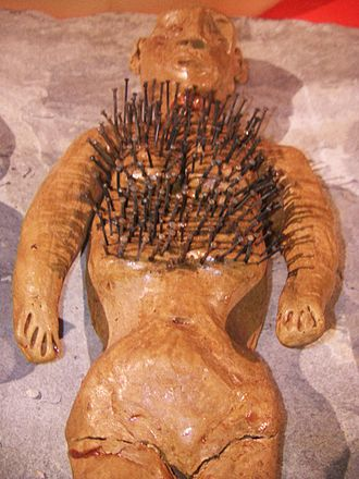 Voodoo doll - A humanoid figurine with pins stuck into it: this was one method by which cunning folk battled witches using magical means. Artefact at the Museum of Witchcraft and Magic in Cornwall, England