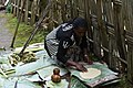 Dorze woman preparing kocho (flat bread) from emset (false banana) (1) (29103355046).jpg