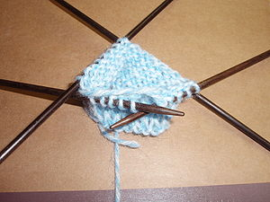 A picture of double point knitting needles in use