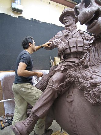 America's Response Monument - Blumberg puts the finishing touches on the clay model of the Horse Soldier Sculpture before the bronze work is begun.
