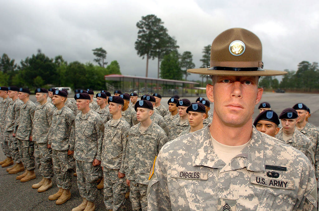 A drill sergeant posing before his company