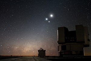 Conjunction (astronomy) - In the night sky over ESO's Very Large Telescope (VLT) observatory at Paranal, the Moon shines along with two bright companions: Venus and Jupiter.