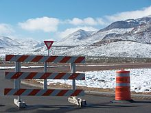 Image of barricades across Woodrow Bean Transmountain Drive with snow across surrounding Franklin Mountains.