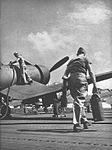 F4U-1 Corsairs are refueled aboard USS Franklin (CV-13) in early 1945.jpg
