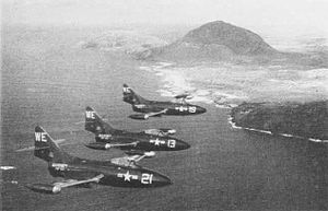 VMA-214 - F9F-2 Panther jets from VMF-214 flying over Oahu in 1953.