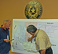 FEMA - 37507 - FEMA and a State emergency manager surveying a map in Texas.jpg