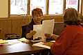 FEMA - 41036 - FEMA Individual Assitance specialist helping a resident in Minnesota.jpg