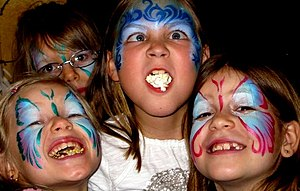 English: happy kids with their painted face De...