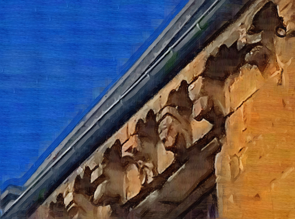 Faces on the old former abbay in the Romanesque style.