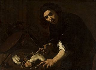 A man flaying a fish.