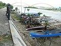 Fishermen and boat on the river Palu - panoramio (1).jpg