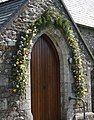 Floral Decoration on the Church Porch - geograph.org.uk - 159589.jpg