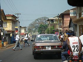 Street-level view of Freetown showing Cotton Tree in the distance.