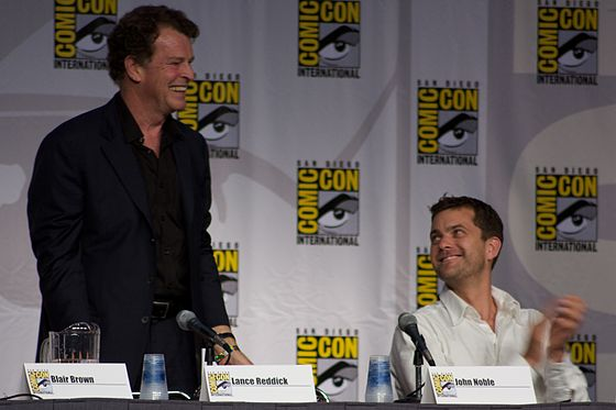 "John Noble (picture left) called his character's nudity the series' ""funniest thing yet"". Fringe Panel 15 2010 CC.jpg"