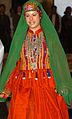 GI walks down the runway during a fashion show dressed in a colorful, traditional Afghan dress. The March 3, 2008.jpg