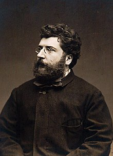 Georges Bizet, aged 37, a bearded man with spectacles in a dark coat