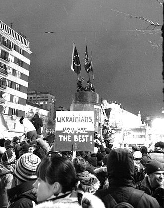 Vladimir Lenin monument, Kiev - Demonstrators on the plinth of the statue after it was toppled