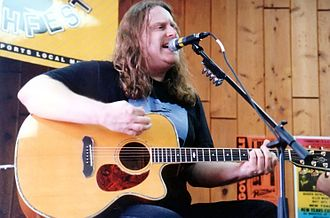 Warren Haynes - Haynes playing an acoustic set with Gov't Mule, early in the band's career, at a record store in Fort Lauderdale, Florida.