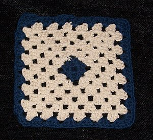 Granny square - A granny square worked in two colors and seven rounds. Cotton, 4 mm crochet hook.