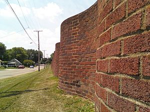 Central Catholic High School (Perry Township, Ohio) - A view of the wall's South Side, along 13th St. SW. Note the sinusoidal undulations